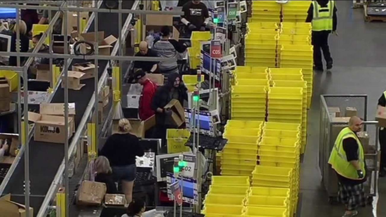 Amazon employees are fulfilling orders at the company's fulfillment center in Tracy, Calif. on Monday, November 30, 2015.