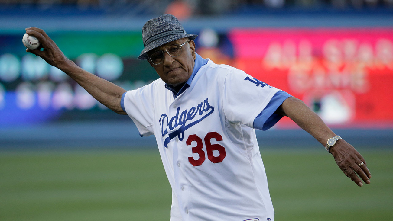 Former Dodgers pitcher Don Newcombe participates in the first pitch ceremony before a baseball game between the Dodgers and the Indians in Los Angeles on  July 1, 2014.
