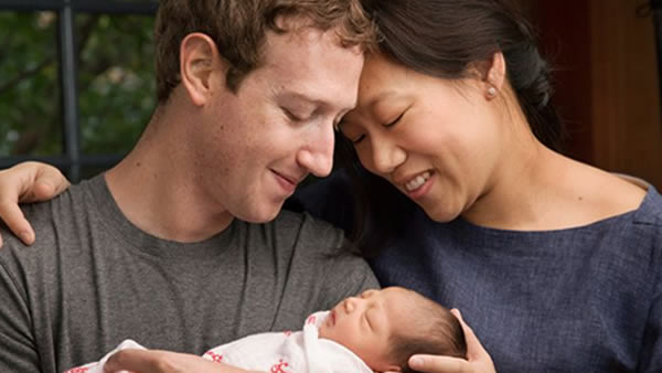 In this image, Mark Zuckerberg and his wife Priscilla Chan pose with their first daughter named Max.