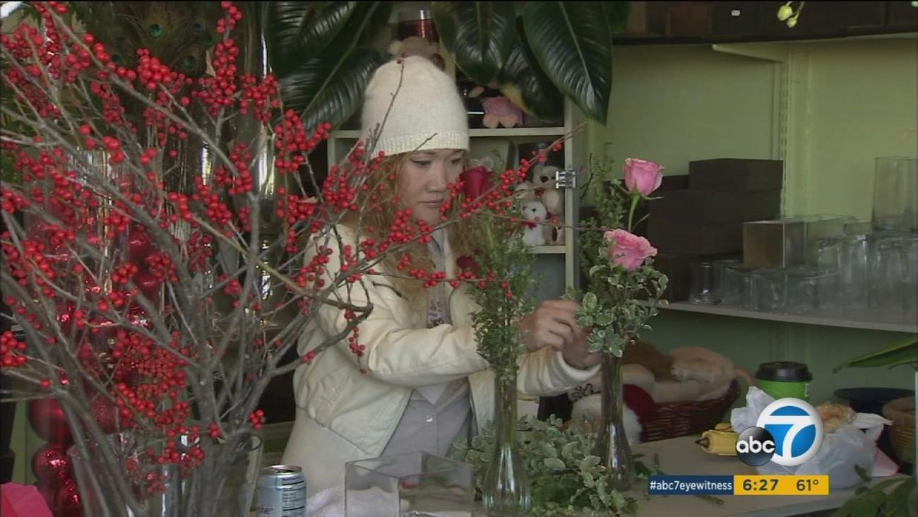 A florist works on an arrangement in an undated photo.