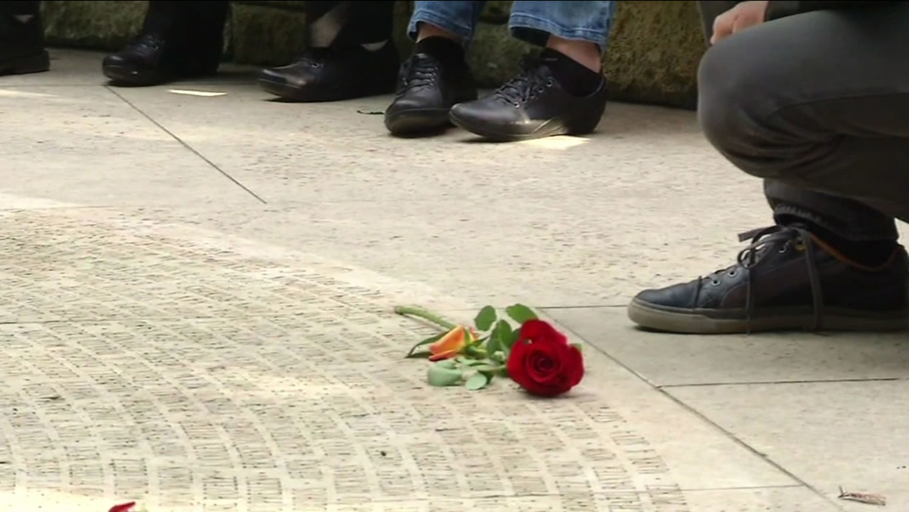 A rose is laid on the ground in the AIDS Memorial Grove in San Francisco on World AIDS Day Tuesday, December 1, 2015.