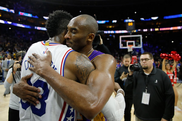 "<div class=""meta image-caption""><div class=""origin-logo origin-image ap""><span>AP</span></div><span class=""caption-text"">Los Angeles Lakers' Kobe Bryant, right, and Philadelphia 76ers' Robert Covington embrace after an NBA basketball game, Tuesday, Dec. 1, 2015, in Philadelphia. (AP Photo/Matt Slocum)</span></div>"