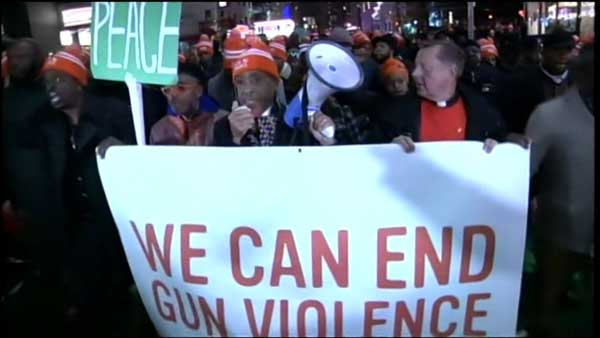 "Spike Lee debuted his new movie ""Chi-Raq"" in New York on Tuesday and took part in an anti-gun march with Chicago's Father Michael Pfleger after the premiere."