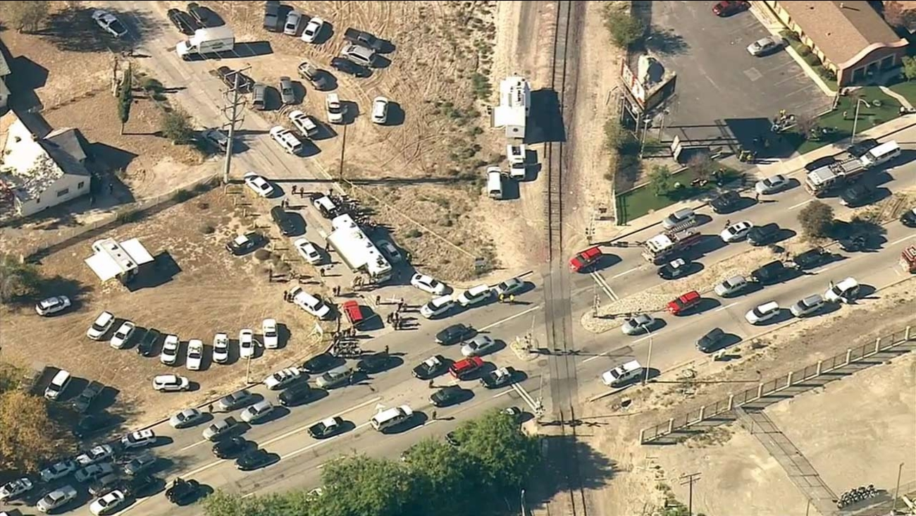 Emergency vehicles converge at the scene of a mass shooting at the Inland Regional Center in San Bernardino on Wednesday, Dec. 2, 2015.