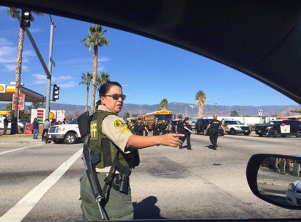 """<div class=""""meta image-caption""""><div class=""""origin-logo origin-image none""""><span>none</span></div><span class=""""caption-text"""">Armed officials unloading in San Bernardino. (mattgutmanABC/Twitter)</span></div>"""