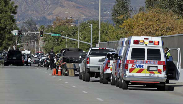 "<div class=""meta image-caption""><div class=""origin-logo origin-image none""><span>none</span></div><span class=""caption-text"">Law enforcement members line up near the the site of a mass shooting on Wednesday, Dec. 2, 2015 in San Bernardino, Calif. (AP Photo/ Chris Carlson)</span></div>"