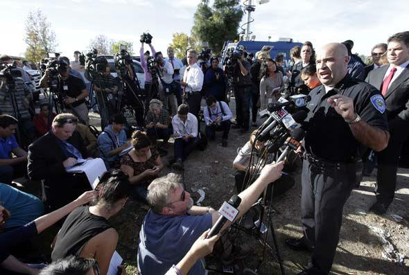 "<div class=""meta image-caption""><div class=""origin-logo origin-image none""><span>none</span></div><span class=""caption-text"">San Bernardino Police Chief Jarrod Burguan, right, talks to the media near the the site of a mass shooting on  Wednesday, Dec. 2, 2015, in San Bernardino, Calif. (AP Photo/ Chris Carlson)</span></div>"