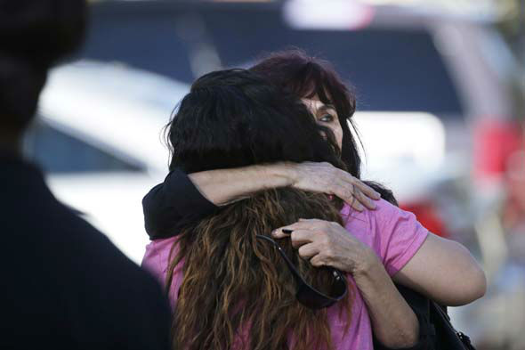"<div class=""meta image-caption""><div class=""origin-logo origin-image none""><span>none</span></div><span class=""caption-text"">Teresa Hernandez, facing camera, is comforted by a woman as she arrives at a social services center in San Bernardino, Calif. (AP Photo/ Jae C. Hong)</span></div>"