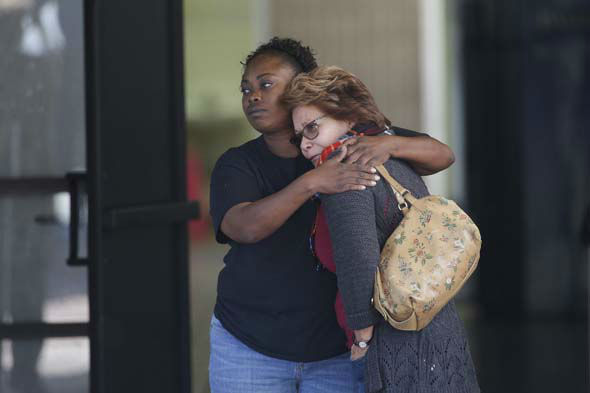 "<div class=""meta image-caption""><div class=""origin-logo origin-image none""><span>none</span></div><span class=""caption-text"">Two women embrace at a community center where family members are gathering to pick up survivors after a shooting rampage at a social services center in San Bernardino, Calif. (AP Photo/ Jae C. Hong)</span></div>"
