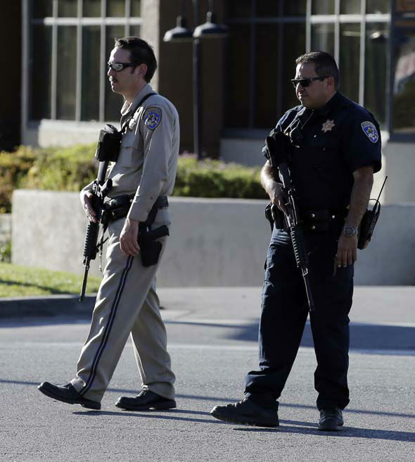 "<div class=""meta image-caption""><div class=""origin-logo origin-image none""><span>none</span></div><span class=""caption-text"">Law enforcement officers block a street near the site of a mass shooting that killed multiple people at a social services center in San Bernardino, Calif. (AP Photo/ Chris Carlson)</span></div>"