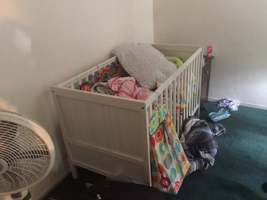 <div class='meta'><div class='origin-logo' data-origin='none'></div><span class='caption-text' data-credit=''>A crib filled with clothes and toys is found inside one of the rooms of a Redlands home connect to the San Bernardino shooting suspects.</span></div>