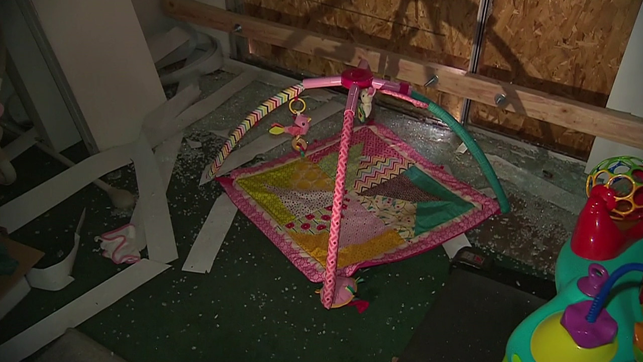 <div class='meta'><div class='origin-logo' data-origin='none'></div><span class='caption-text' data-credit=''>An infant toy sit among shattered glass and damaged window blinds inside the Redlands home connected to the shooting suspects.</span></div>