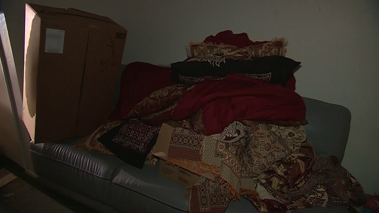 <div class='meta'><div class='origin-logo' data-origin='none'></div><span class='caption-text' data-credit=''>Blankets and packages were stacked on a couch inside the living room of a Redlands home connected to the shooting suspects.</span></div>