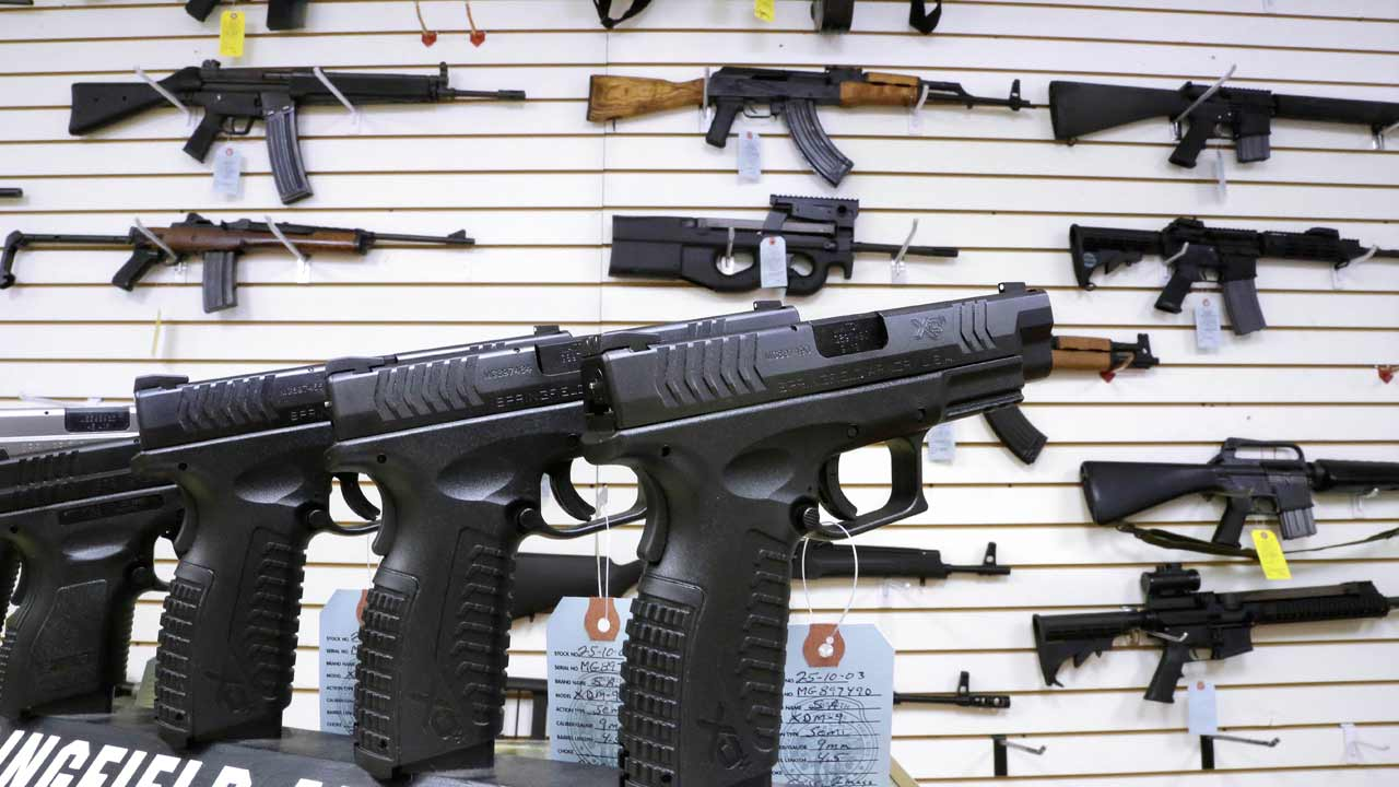 In this Jan. 16, 2013 file photo, assault weapons and hand guns are seen for sale at Capitol City Arms Supply in Springfield, Ill.