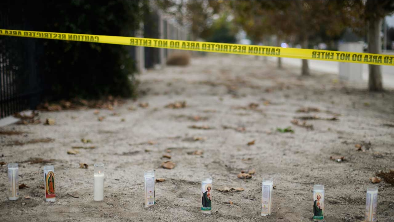 Candles are placed at a makeshift memorial site honoring the victims of Wednesday's shooting rampage, Friday, Dec. 4, 2015, in San Bernardino, Calif.