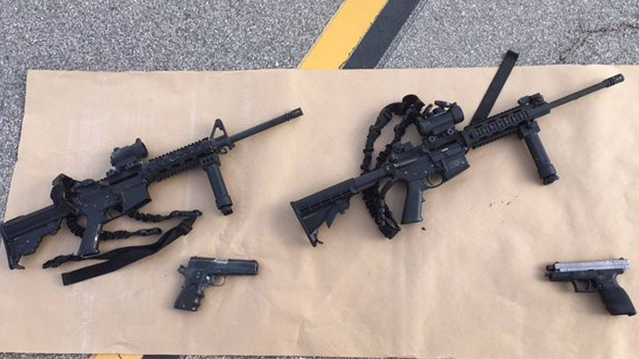 """The two """"assault-style"""" rifles and handguns used in the deadly San Bernardino attacks are shown in an image taken on Wednesday, Dec. 2, 2015."""
