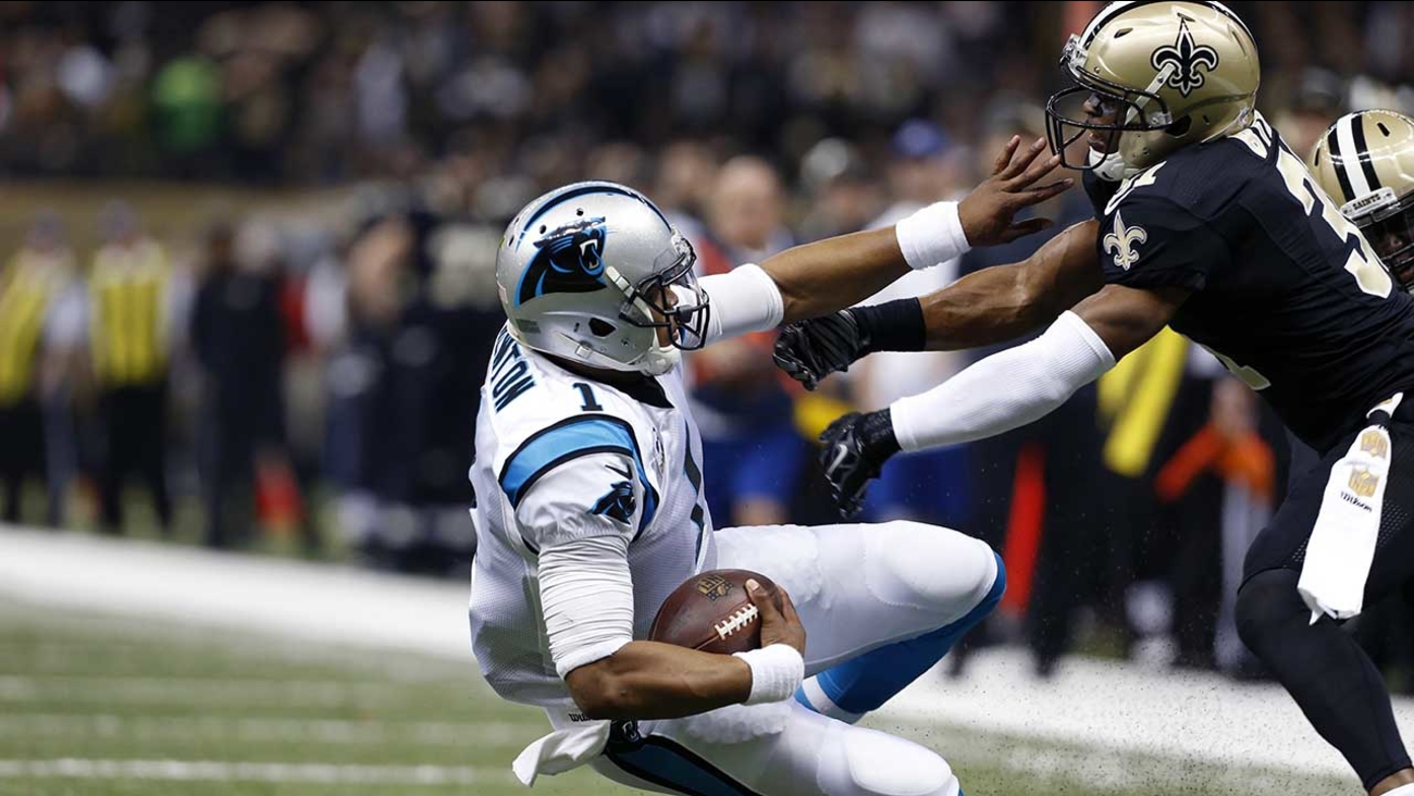 Carolina Panthers quarterback Cam Newton (1) is brought down by New Orleans Saints free safety Jairus Byrd (31) in the first half of an NFL football game in New Orleans