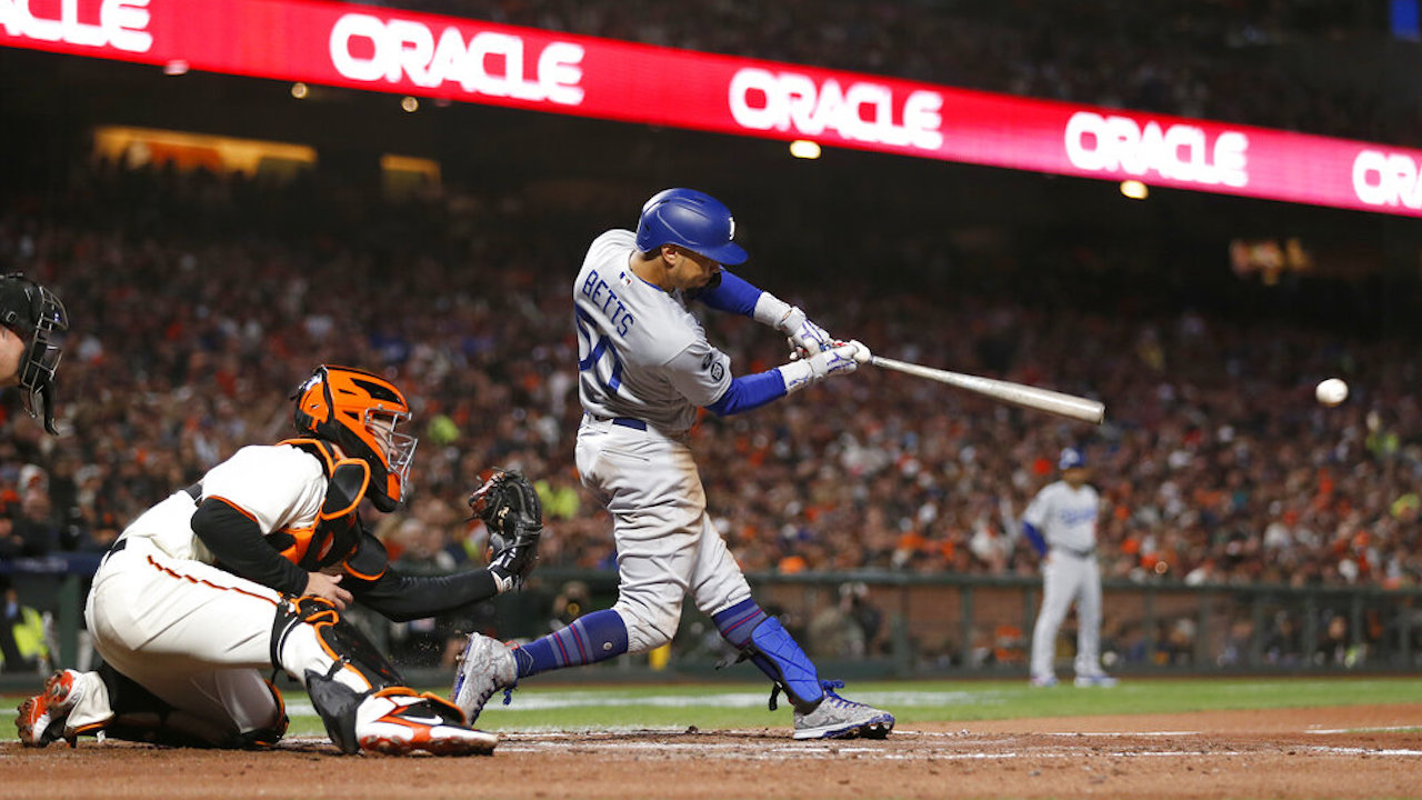 The Dodgers' Mookie Betts hits a single during Game 5 of the National League Division Series against the Giants, Thursday, Oct. 14, 2021, in San Francisco.