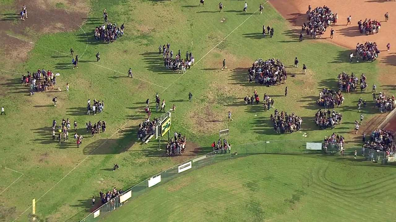 Mira Costa High School students were evacuated to the sports fields after the school received a bomb threat call on Monday, Dec. 7, 2015.