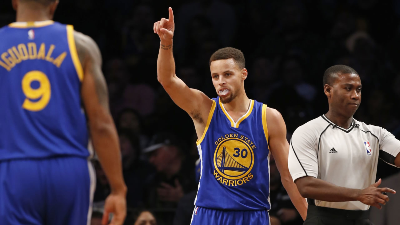 Golden State Warriors guard Stephen Curry (30) reacts after scoring in the second half of an NBA basketball game against the Brooklyn Nets, Sunday, Dec. 6, 2015, in New York.