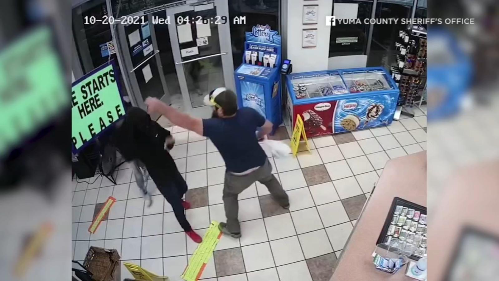 Video shows Marine veteran single-handedly disarming robber at gas station in Arizona