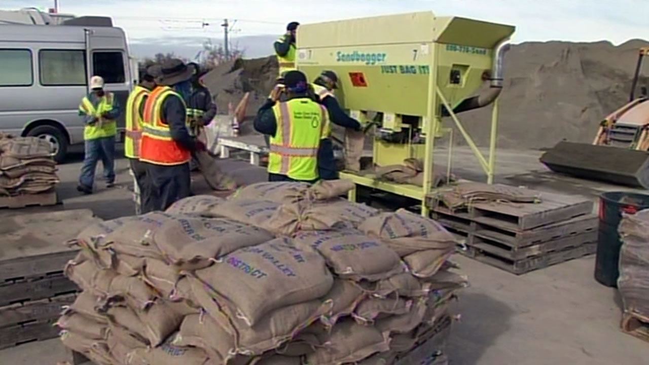 Crews fill sandbags at a Santa Clara Valley Water District facility in San Jose, Calif. on Wednesday, December 9, 2015.