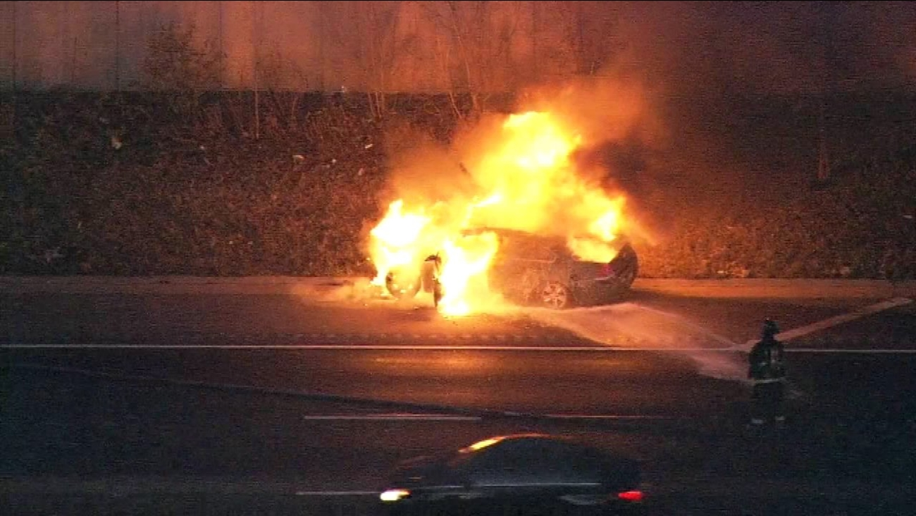 A car burst into flames on outbound I-57 near 111th Street Friday morning.