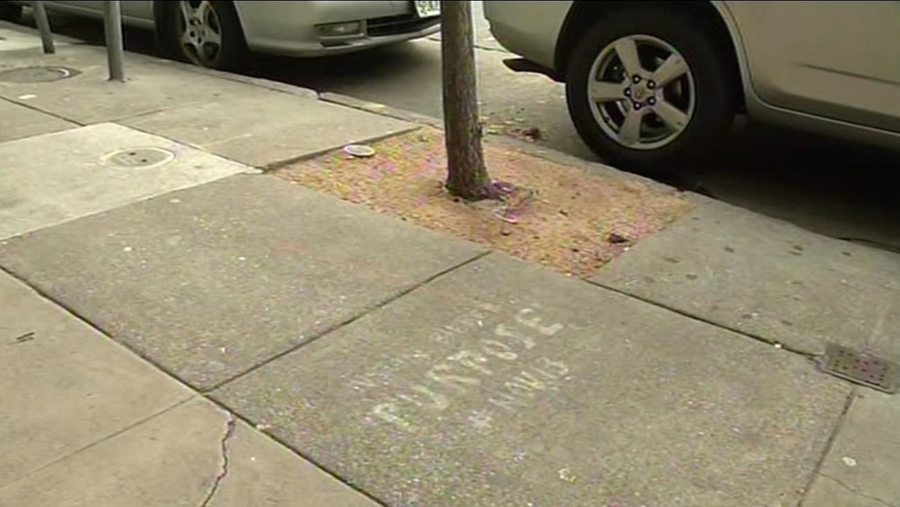 "Graffiti sprayed on this San Francisco sidewalk on Friday, December 11, 2015 is promoting Justin Bieber's album ""Purpose."""
