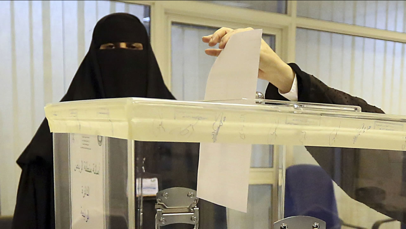 Saudi women vote at a polling center during the municipal elections, in Riyadh, Saudi Arabia, Saturday, Dec. 12, 2015.