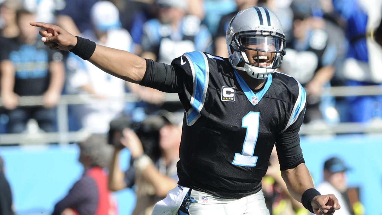 Carolina Panthers' Cam Newton (1) celebrates after a touchdown against the Atlanta Falcons in the first half of an NFL football game in Charlotte, N.C., Sunday, Dec. 13, 2015.