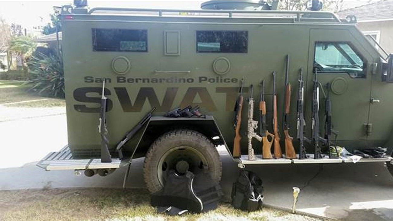 Thirteen firearms, including three unregistered assault rifles, and ballistic vests were among a cache of items found at a home in Riverside on Dec. 11, 2015.