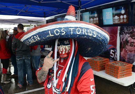 "<div class=""meta image-caption""><div class=""origin-logo origin-image none""><span>none</span></div><span class=""caption-text"">Texans fans before the Patriots game</span></div>"