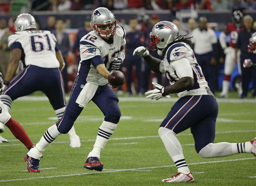 "<div class=""meta image-caption""><div class=""origin-logo origin-image none""><span>none</span></div><span class=""caption-text"">New England Patriots quarterback Tom Brady (12) hands off to running back LeGarrette Blount (29) (AP Photo/ David J. Phillip)</span></div>"