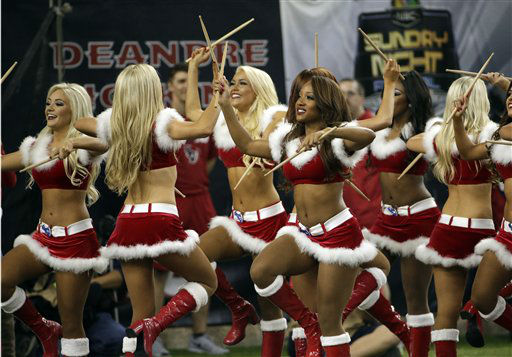 "<div class=""meta image-caption""><div class=""origin-logo origin-image none""><span>none</span></div><span class=""caption-text"">The Houston Texans cheerleaders perform dressed in holiday costume (AP Photo/ David J. Phillip)</span></div>"