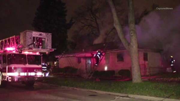 A firefighter is hurt and a family's pet was killed in a large house fire in south suburban Calumet Park.