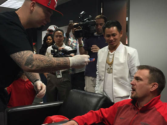 <div class='meta'><div class='origin-logo' data-origin='none'></div><span class='caption-text' data-credit='Photo/ABC13'>UH Coach Tom Herman makes good on promise to get fitted for grill after Cougars win AAC.</span></div>