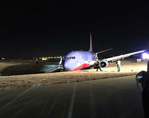 <div class='meta'><div class='origin-logo' data-origin='none'></div><span class='caption-text' data-credit='Photo/iWitness Reports'>Viewer photos of the plane from Houston to Nashville that went off the runway Tuesday night.</span></div>