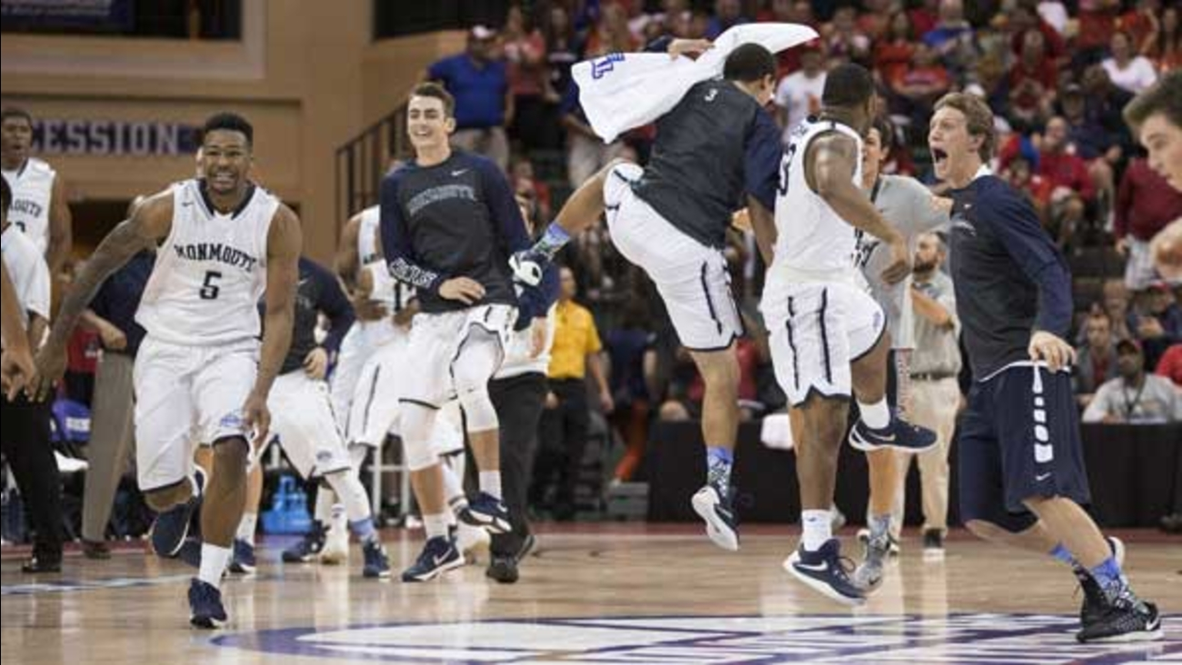 Monmouth players celebrate a 70-68 win over Notre Dame in an NCAA college basketball game in Orlando, Fla.