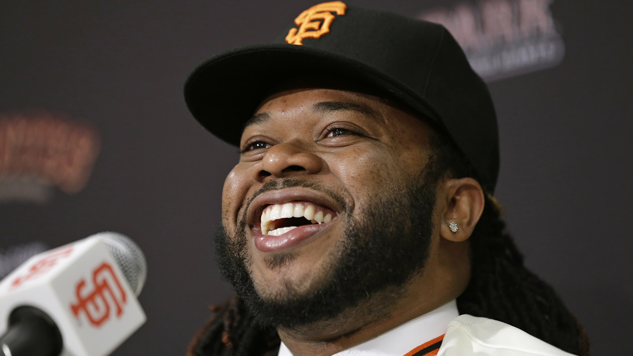 San Francisco Giants pitcher Johnny Cueto smiles during a media availability Thursday, Dec. 17, 2015, in San Francisco.  (AP Photo/Eric Risberg)