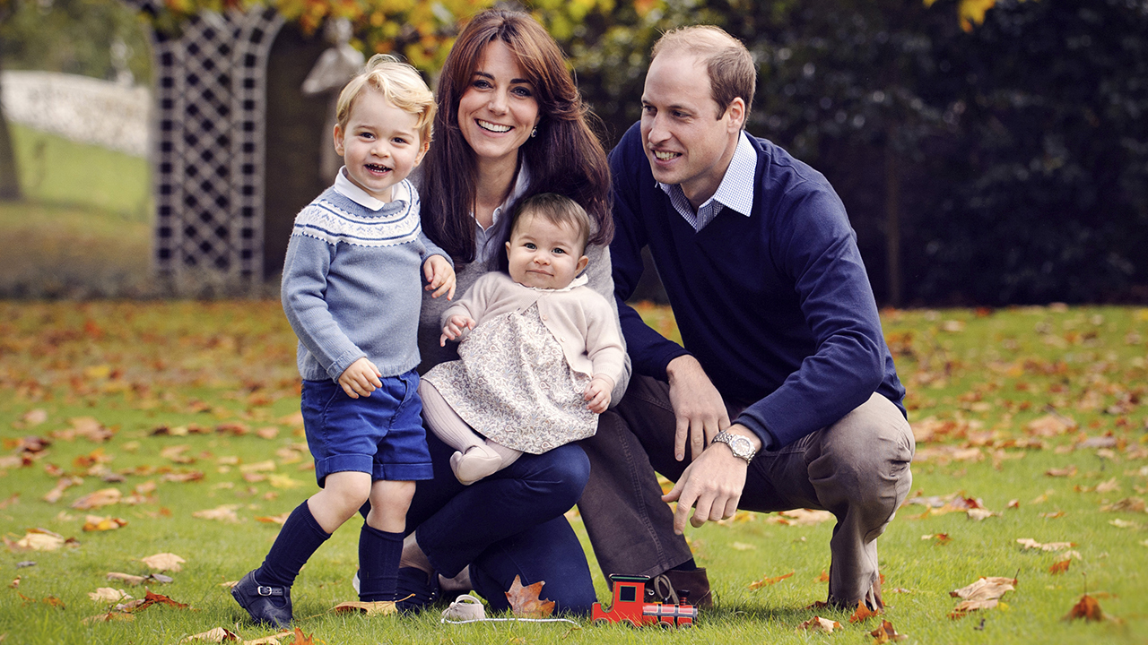This photo released by Kensington Palace on Friday Dec. 18, 2015 shows The Duke and Duchess of Cambridge with their two children