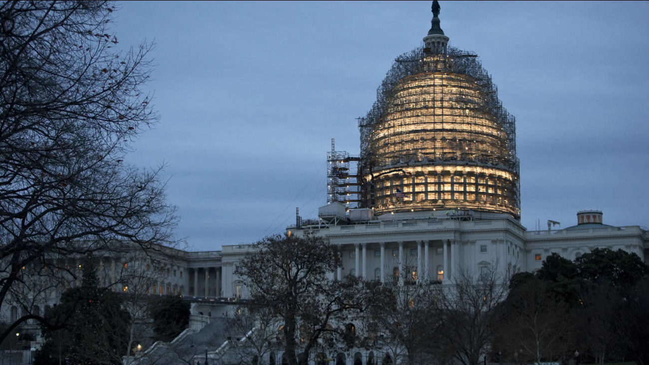 The Capitol Dome is illuminated amid scaffolding for repairs in Washington, Friday morning, Dec. 18, 2015. The House and Senate race to wrap up votes on a massive spending and tax package.
