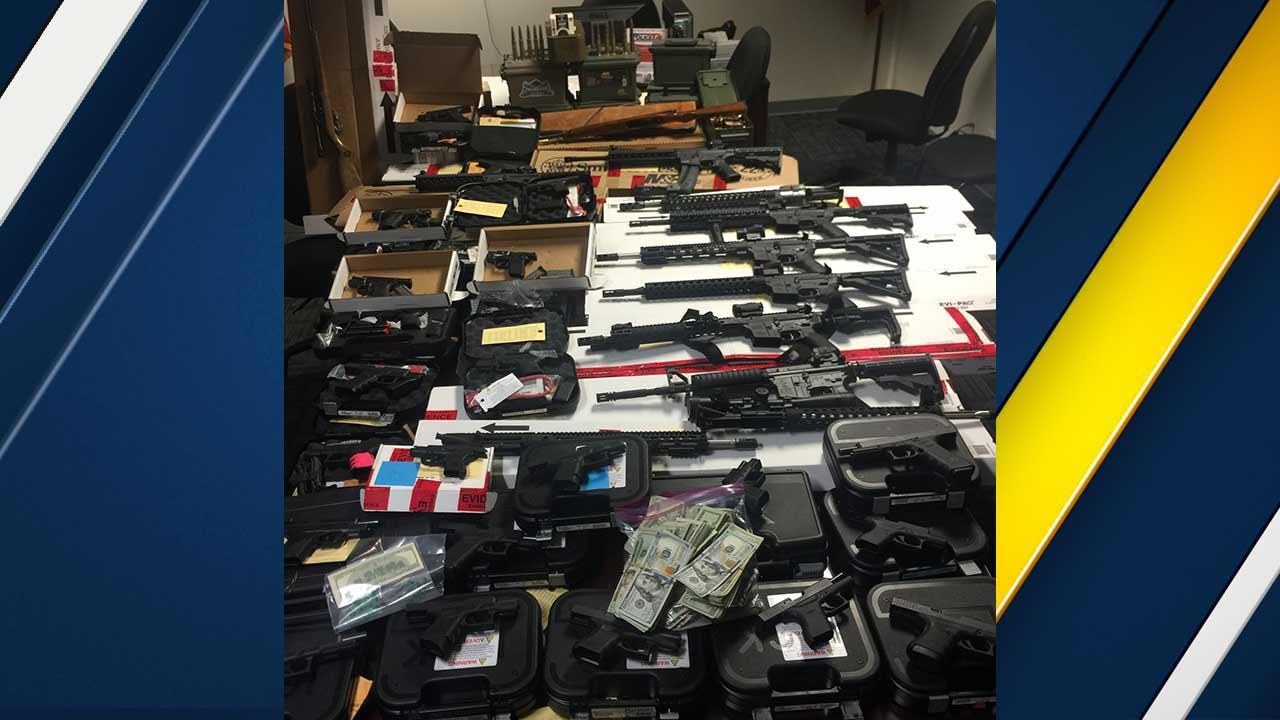 La Habra police seized dozens of weapons, 40 pounds of marijuana and $44,700 in cash during a search warrant at three locations on Thursday, Dec. 17, 2015.
