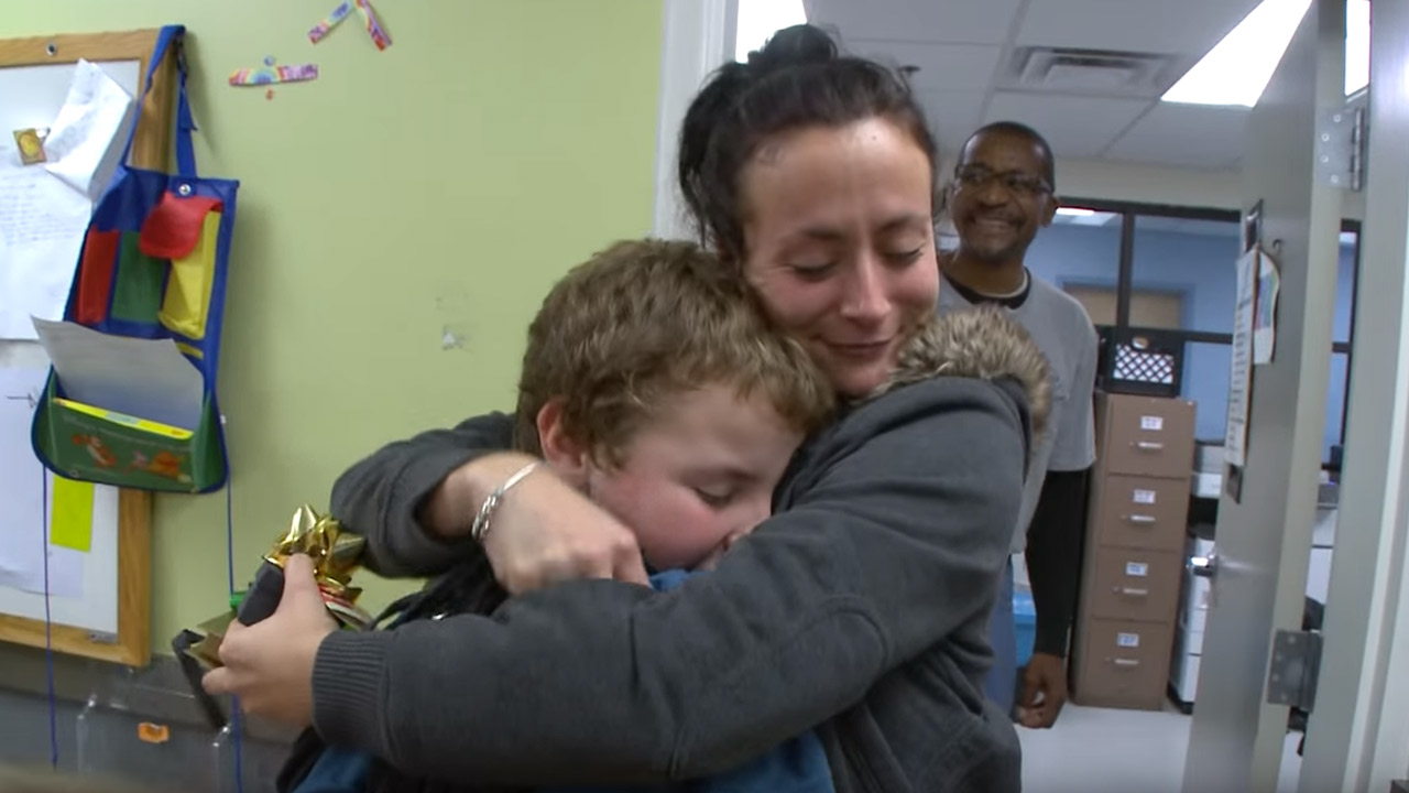 A child hugs his mother after giving her a Christmas gift at the Boys & Girls Club of Metro Atlanta.