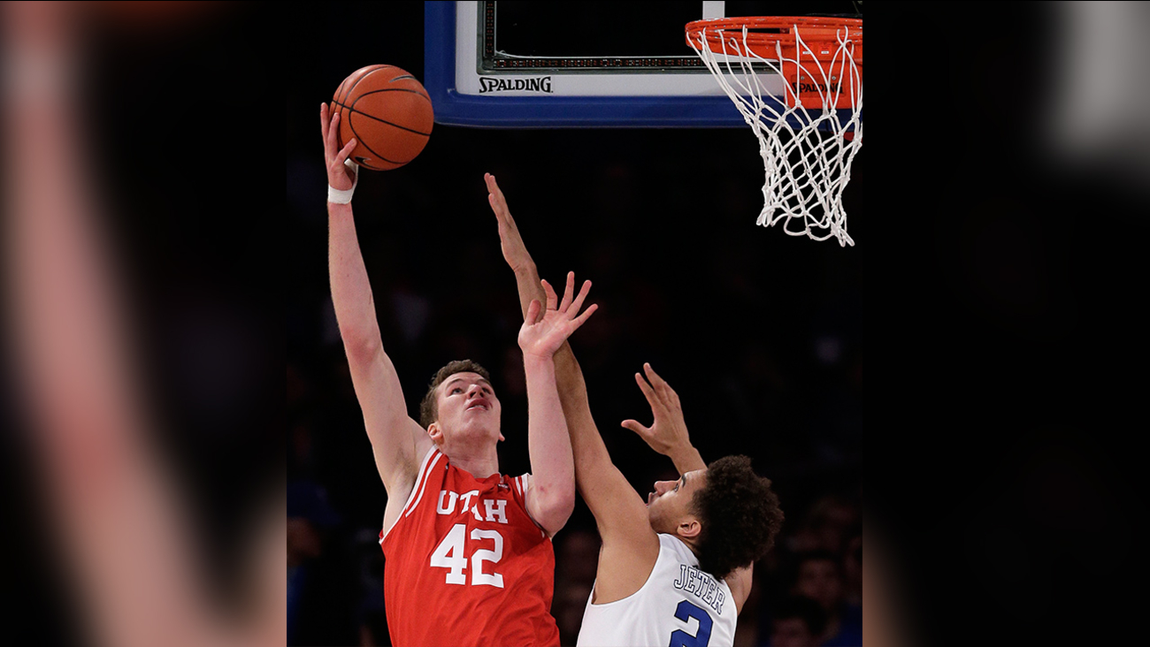 Utah forward Jakob Poeltl (42) puts up a shot against Duke forward Chase Jeter (2) during the first half of an NCAA college basketball game, Saturday, Dec. 19, 2015, in New York.