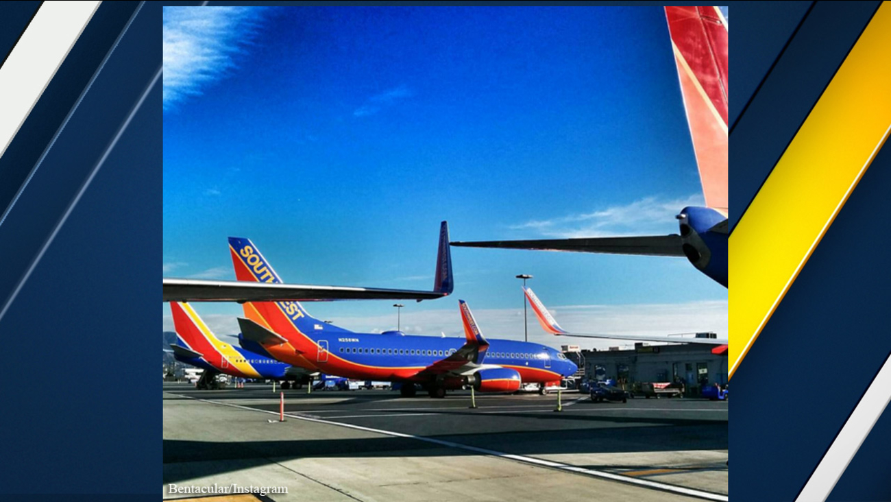 A photo posted to social media by a passenger appears to show the wings of two Southwest Airline aircraft touching at Burbank's Bob Hope Airport on Sunday, Dec. 20, 2015.