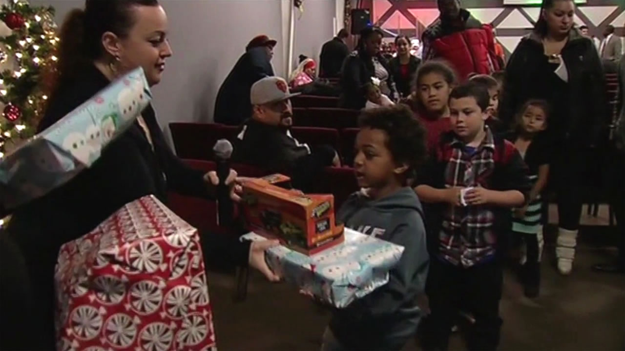 Volunteers at Sacred Heart Community Service in San Jose, Calif. sort through donated toys on Sunday, December 20, 2015. (KGO-TV)