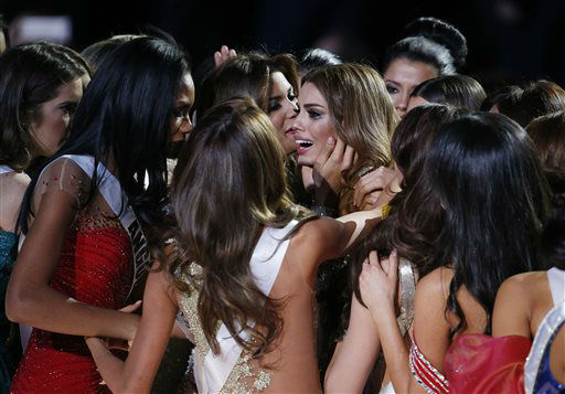 <div class='meta'><div class='origin-logo' data-origin='none'></div><span class='caption-text' data-credit='AP Photo/ John Locher'>Other contestants comfort Miss Colombia Ariadna Gutierrez, center, after she was incorrectly crowned Miss Universe</span></div>
