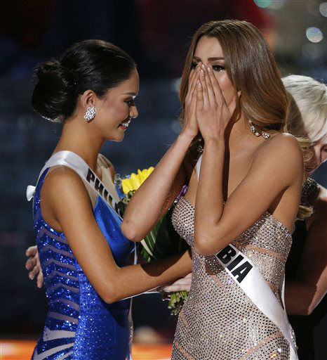 <div class='meta'><div class='origin-logo' data-origin='none'></div><span class='caption-text' data-credit='AP Photo/ John Locher'>Miss Colombia Ariadna Gutierrez, right, reacts as the announcer incorrectly names her the new Miss Universe</span></div>