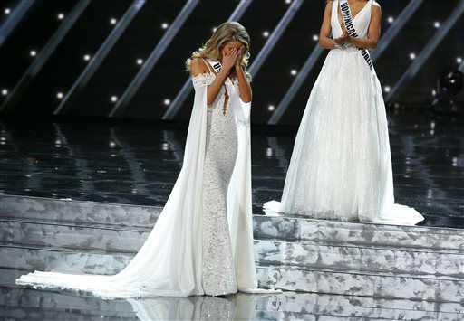 <div class='meta'><div class='origin-logo' data-origin='none'></div><span class='caption-text' data-credit='AP Photo/ John Locher'>Miss USA Olivia Jordan reacts as she makes it into the final five at the Miss Universe pageant Sunday, Dec. 20, 2015, in Las Vegas.</span></div>