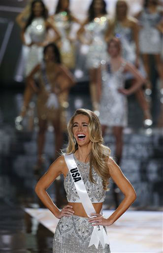 <div class='meta'><div class='origin-logo' data-origin='none'></div><span class='caption-text' data-credit='AP Photo/ John Locher'>Miss USA Olivia Jordan reacts after making the final 15 at the Miss Universe pageant Sunday, Dec. 20, 2015, in Las Vegas.</span></div>